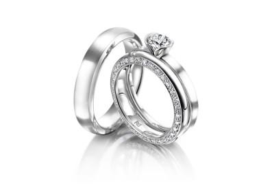 Solitaire Ring mit Beisteckring und Trauring